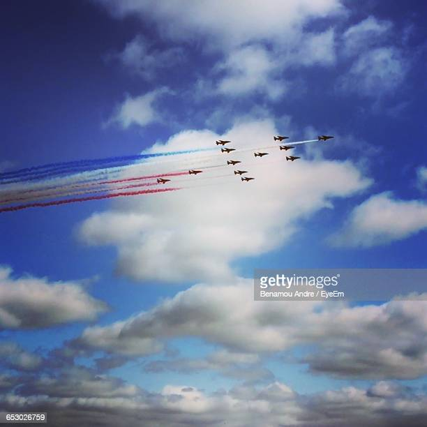 Low Angle View Of Patrouille De France In Cloudy Sky
