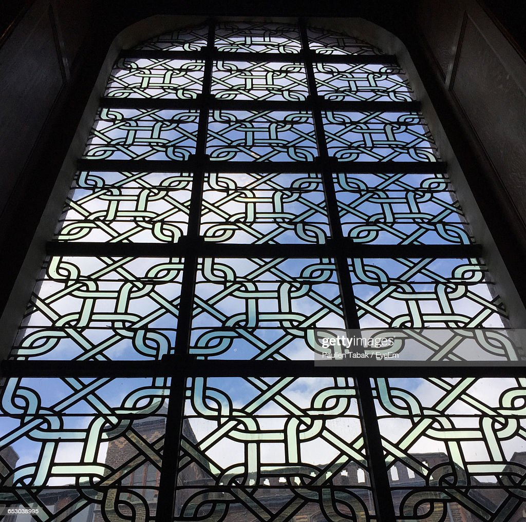 Low Angle View Of Patterned Window : Stockfoto