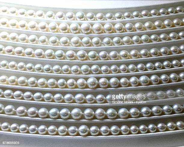 Low Angle View Of Pearl Jewelries In Shelf At Store
