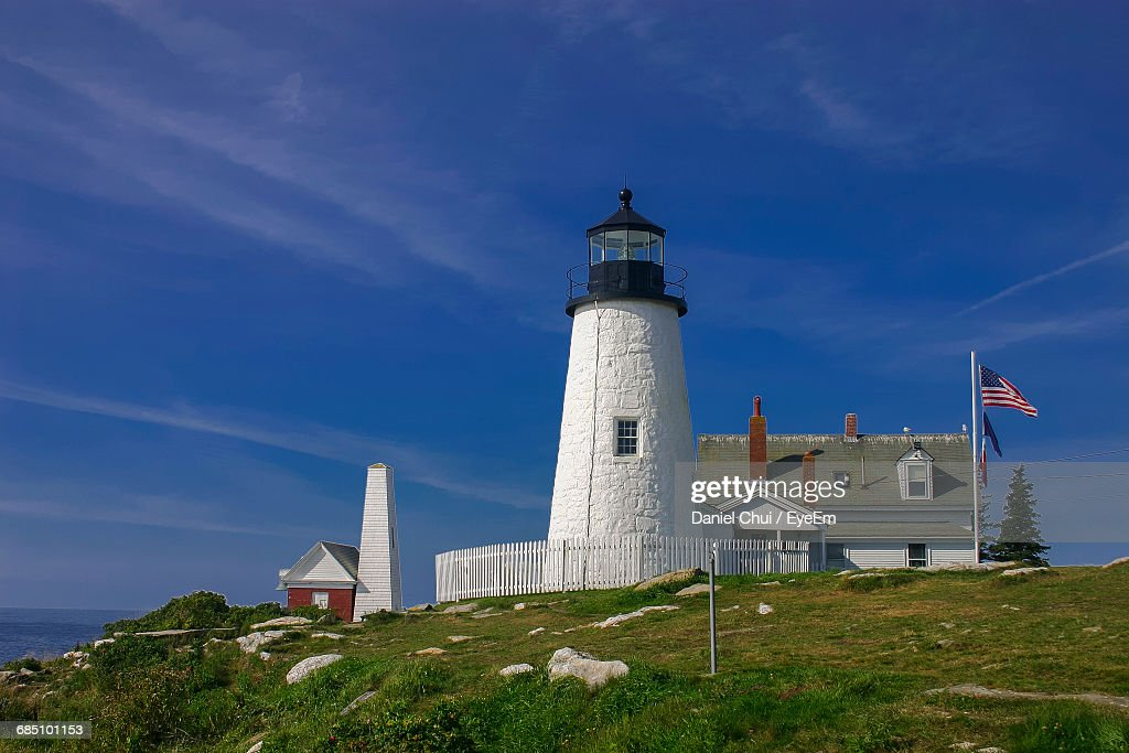 Low Angle View Of Pemaquid Point Light And American Flag Against Blue Sky : Stock Photo