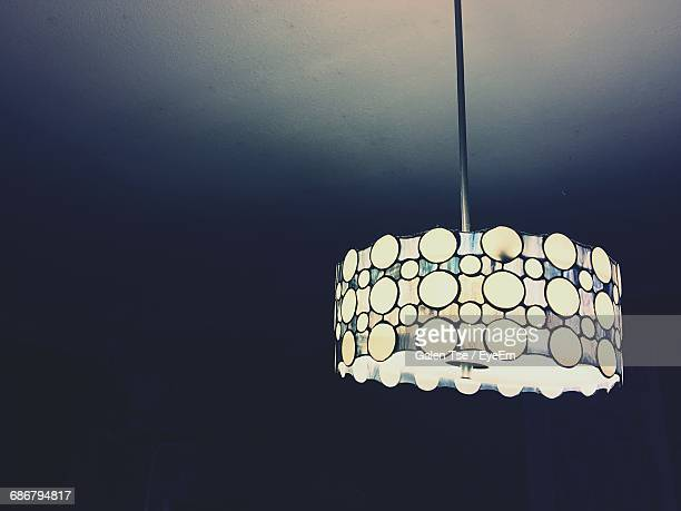 low angle view of pendant light hanging at ceiling - 家庭の備品 ストックフォトと画像