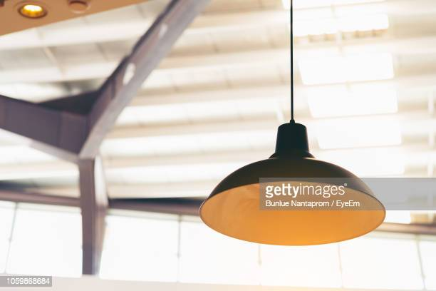 low angle view of pendant light hanging from ceiling - pendant light stock pictures, royalty-free photos & images