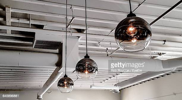 Low Angle View Of Pendant Lights Hanging From Ceiling