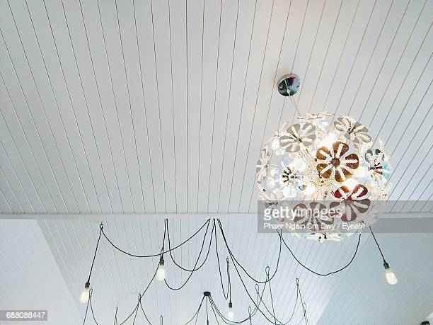 Light fixture getty images low angle view of pendant lights hanging from ceiling mozeypictures Gallery