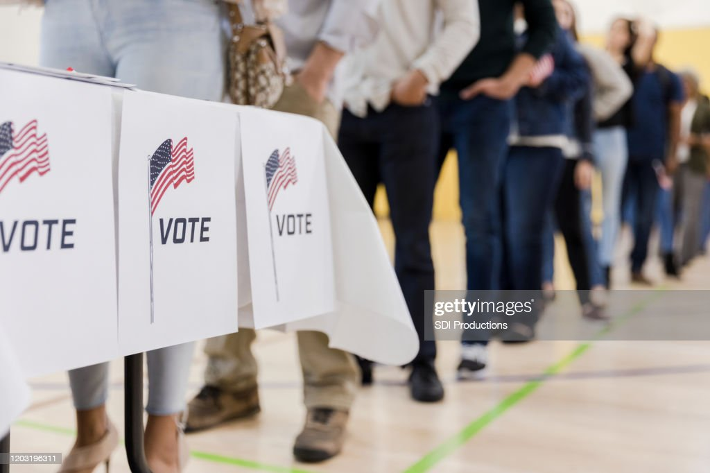 Low angle view of people lined up to vote : Stock Photo