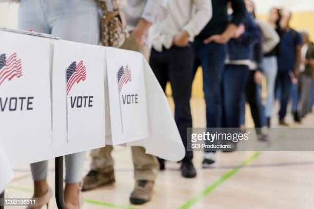 low angle view of people lined up to vote - usa stock pictures, royalty-free photos & images