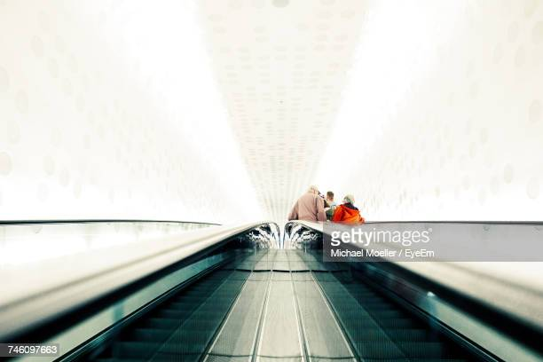 Low Angle View Of People On Escalator