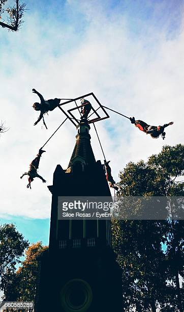 Low Angle View Of People Performing Volador