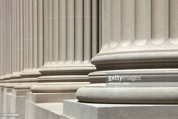 low angle view of perfect white columns - neoklassiek stockfoto's en -beelden