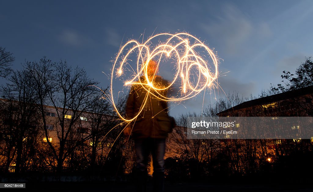 Low Angle View Of Person Doing Light Painting At Night : Stock-Foto