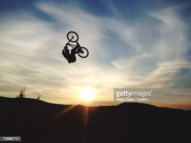 Low Angle View Of Person Doing Stunt With Bike