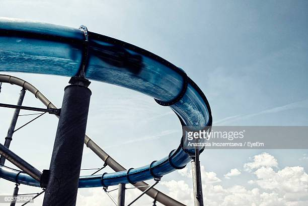 Low Angle View Of Person In Water Slide Against Sky