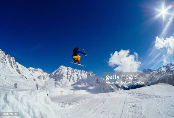 Low Angle View Of Person Jumping On Ski Slope