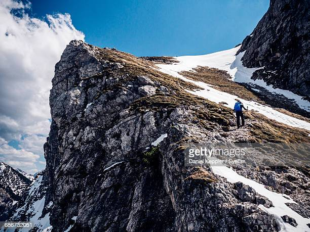 Low Angle View Of Person On Snow Covered Mountain