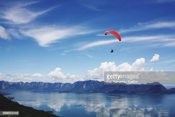 Low Angle View Of Person Parachuting Above Sea