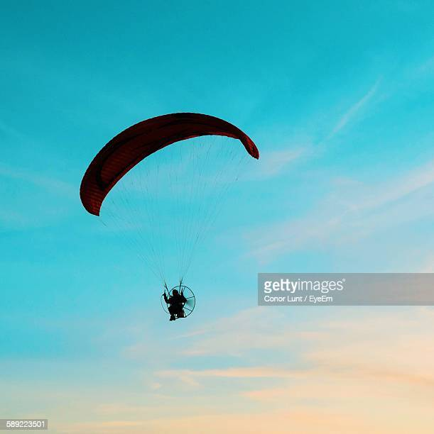 low angle view of person paragliding against sky - conor stock pictures, royalty-free photos & images