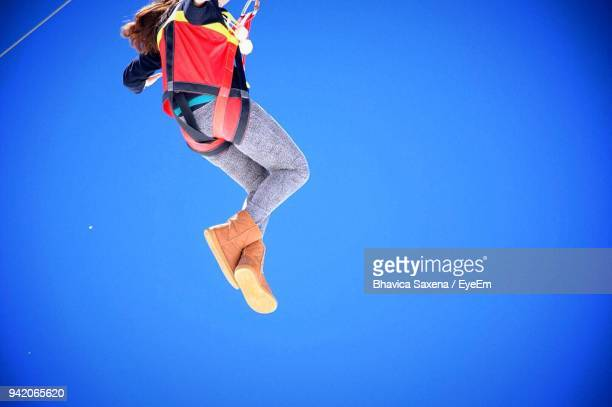 Low Angle View Of Person Skylining Against Clear Blue Sky