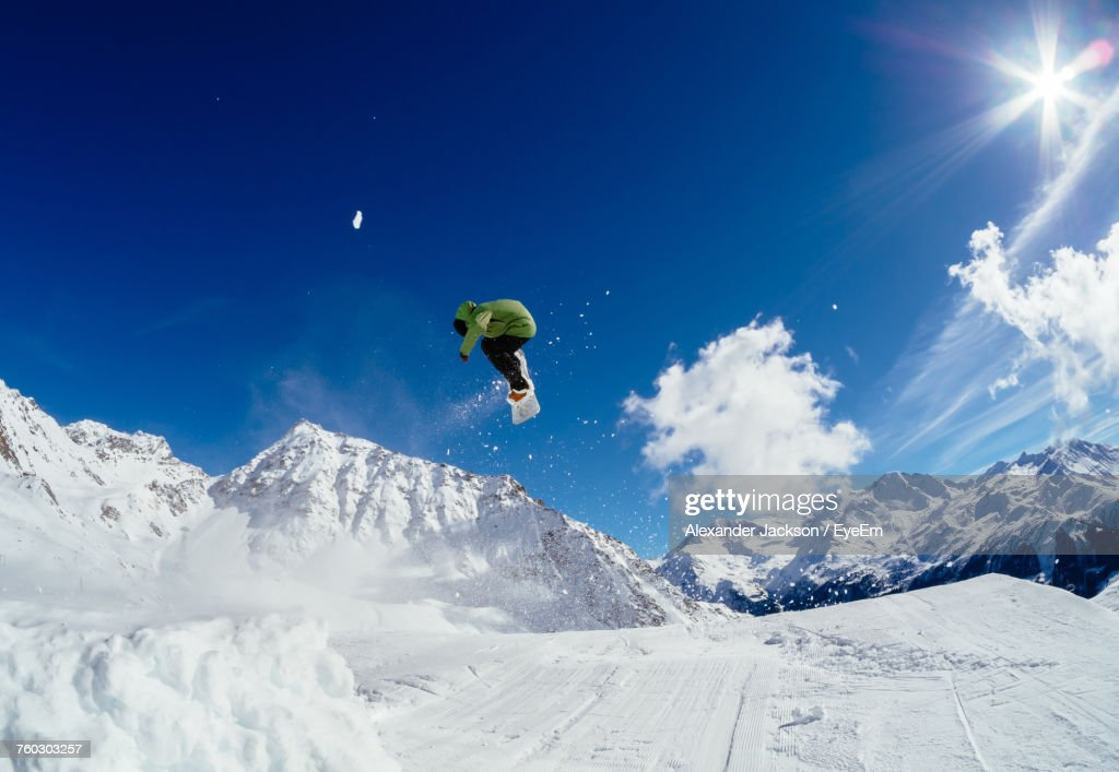Low Angle View Of Person Snowboarding : Stock Photo