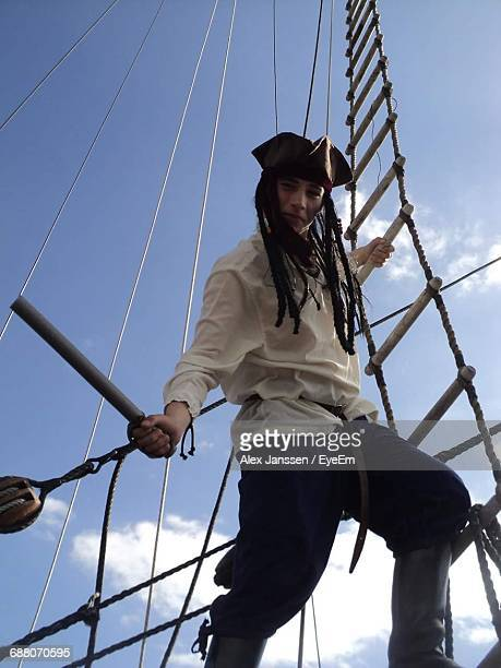 low angle view of person wearing pirate costume - female pirate stock photos and pictures