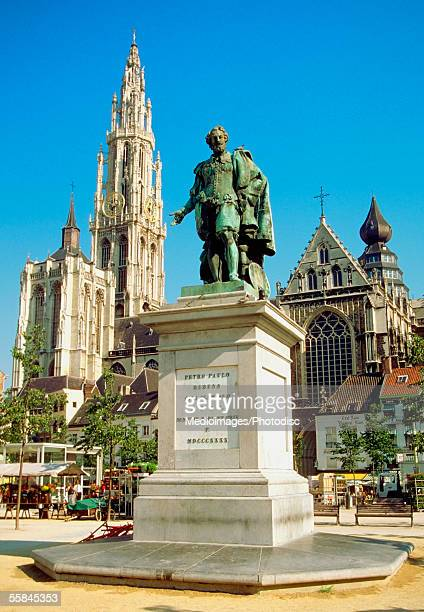 Low angle view of Peter Paul Rubens statue in front of buildings, Cathedral of Our Lady, Antwerp, Belgium