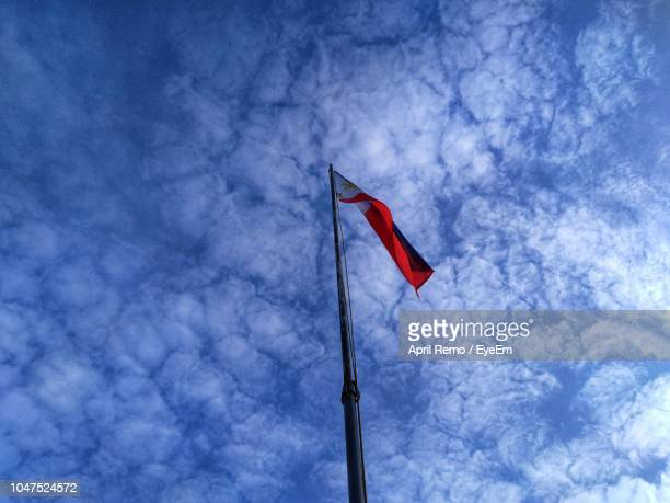 low angle view of philippine flag against blue sky - philippines flag stock pictures, royalty-free photos & images