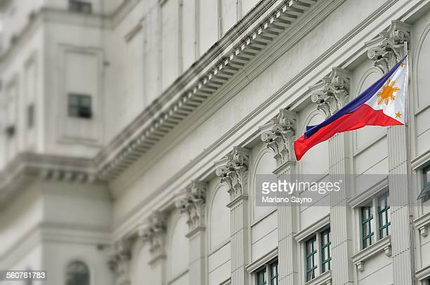 low angle view of philippine flag outside city bui - philippines flag stock pictures, royalty-free photos & images