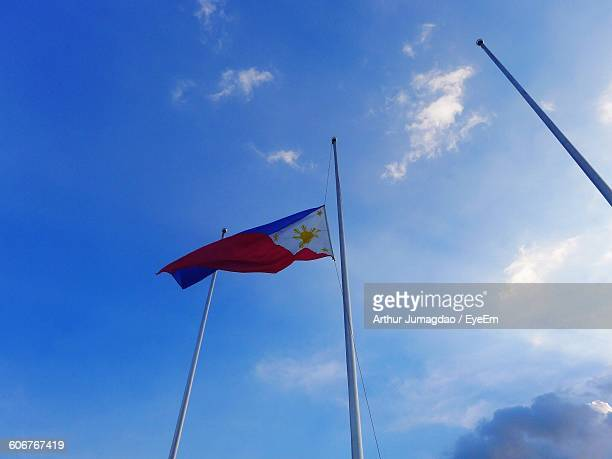 low angle view of philippines flag against blue sky - filipino flag stock pictures, royalty-free photos & images