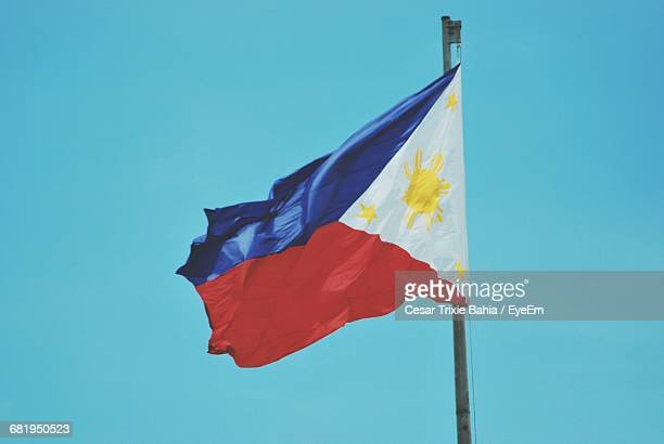 low angle view of philippines flag against clear sky - philippines flag stock pictures, royalty-free photos & images
