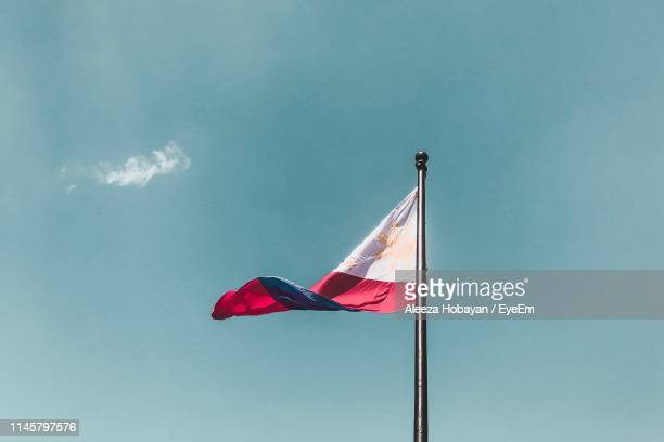 low angle view of philippines flag waving against sky - filipino flag stock pictures, royalty-free photos & images