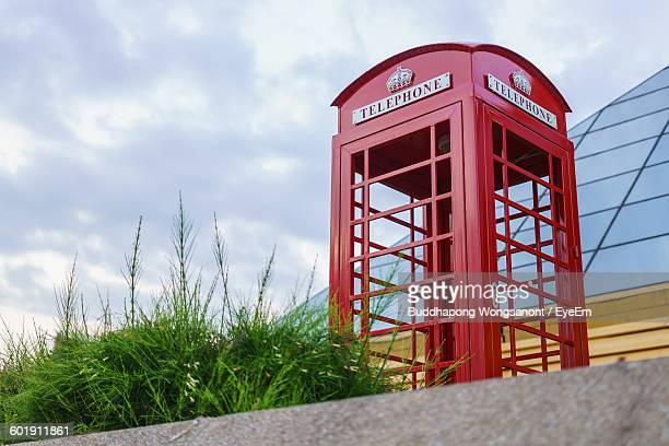 Low Angle View Of Phone Box Against Sky