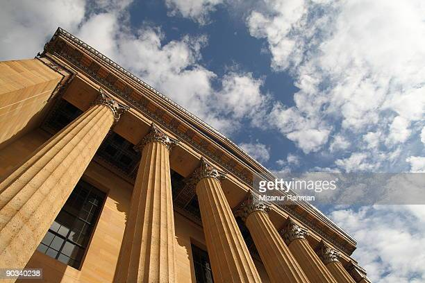 Low angle view of pillars under clouds