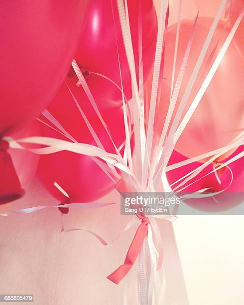 Low Angle View Of Pink And Red Balloons