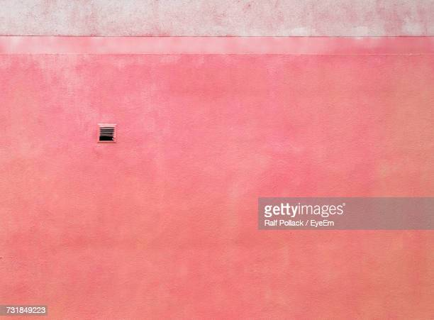 Low Angle View Of Pink Wall
