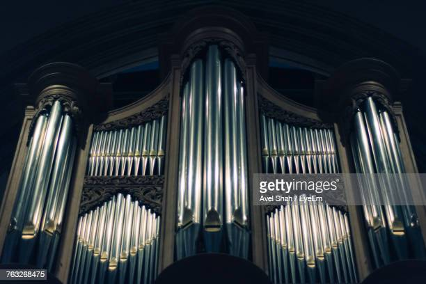 low angle view of pipe organ at church - church organ stock pictures, royalty-free photos & images