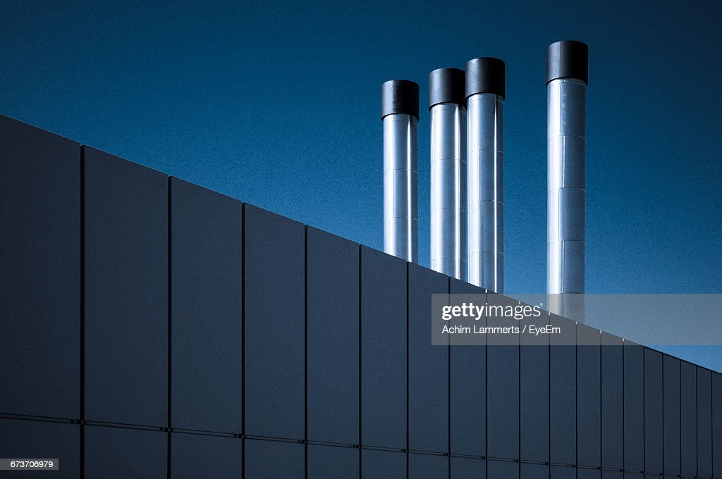 Low Angle View Of Pipes Of Industry : Stock-Foto
