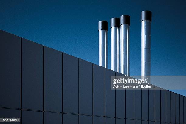 low angle view of pipes of industry - achim lammerts stock-fotos und bilder