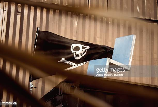 Low Angle View Of Pirate Flag By Wooden Seat