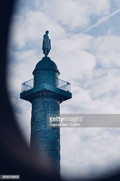 Low Angle View Of Place Vendome Column Against Sky In City Seen Through Window