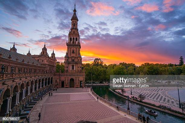 Low Angle View Of Plaza De Espana Against Cloudy Sky During Sunset