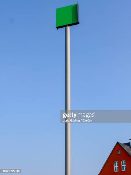 low angle view of pole against clear blue sky - pole stock pictures, royalty-free photos & images