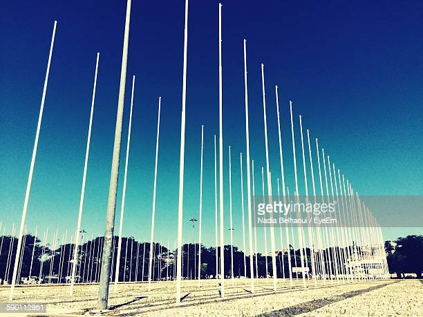 Low Angle View Of Poles Against Blue Sky