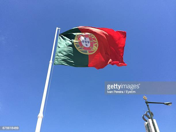 Low Angle View Of Portuguese Flag Against Sky