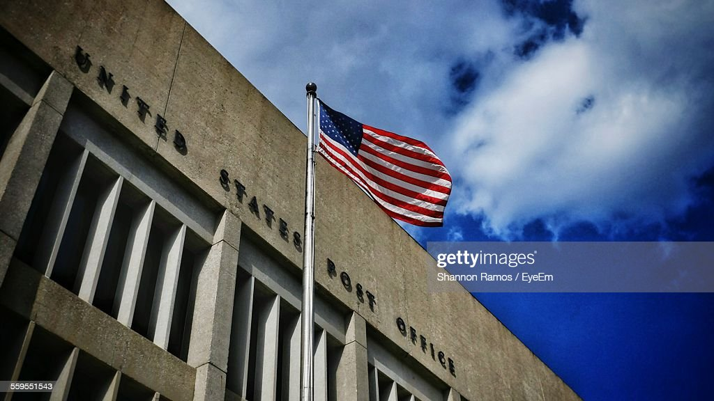 Low Angle View Of Post Office Against Blue Sky : Stock Photo