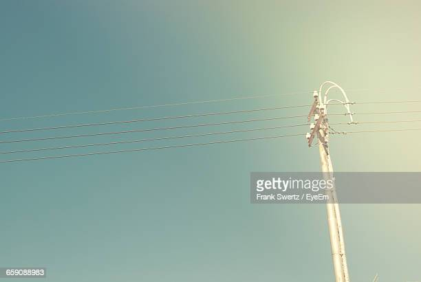 low angle view of power lines against clear sky - frank swertz stock pictures, royalty-free photos & images