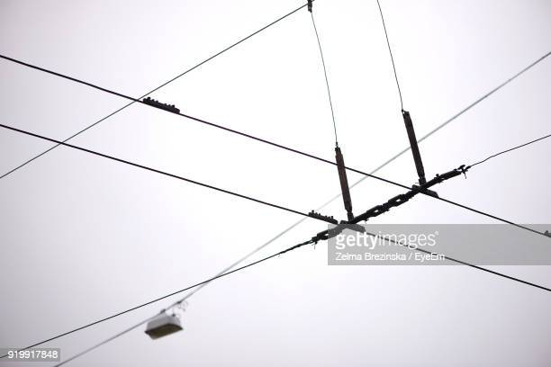 low angle view of power lines against clear sky - brezinska stock pictures, royalty-free photos & images