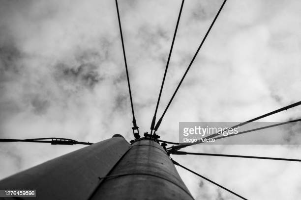 low angle view of power lines against sky - puletto diego stock pictures, royalty-free photos & images