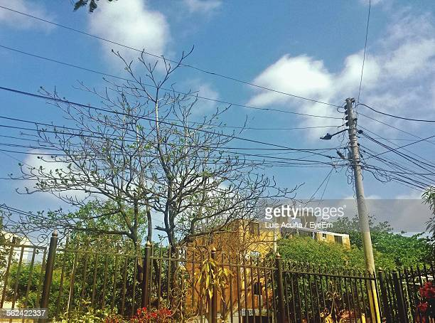 low angle view of power lines against sky - barranquilla stock photos and pictures