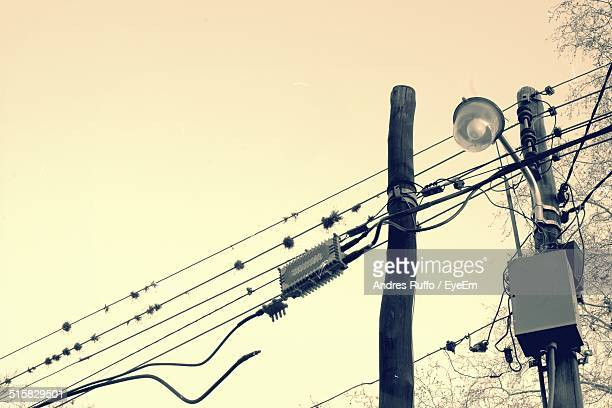 low angle view of power lines and street light - andres ruffo stock pictures, royalty-free photos & images