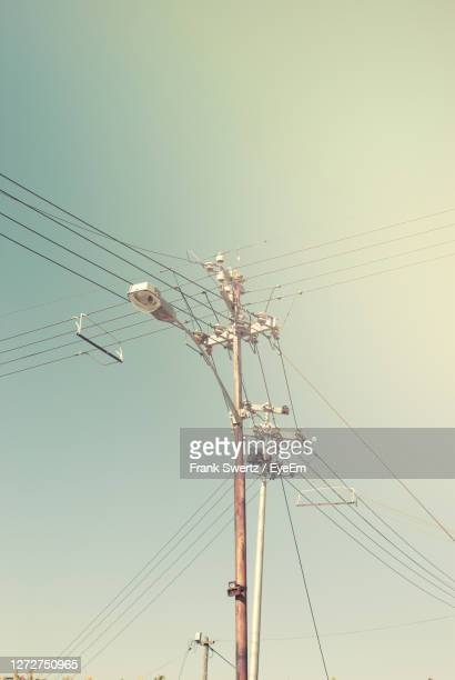 low angle view of power lines - frank swertz stock pictures, royalty-free photos & images