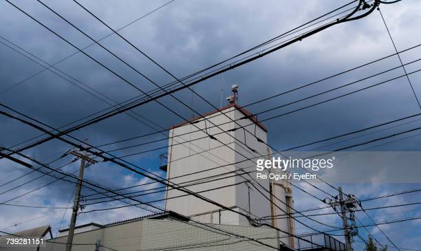 Low Angle View Of Power Linesagainst Sky